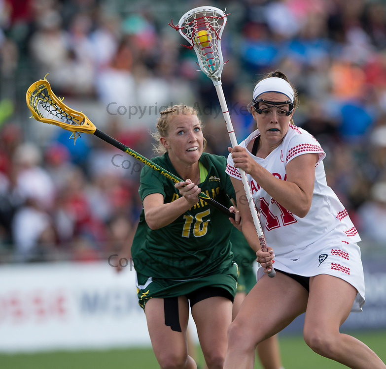 Australia's Ashton Hiron  challenges with Canada's Erica Evans   during their semi-final at the 2017 FIL Rathbones Women's Lacrosse World Cup, at Surrey Sports Park, Guildford, Surrey, UK, 20th July 2017.