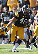 September 29 2012: Iowa Hawkeyes running back Mark Weisman (45) on a run during the first quarter of the NCAA football game between the Minnesota Golden Gophers and the Iowa Hawkeyes at Kinnick Stadium in Iowa City, Iowa on Saturday September 29, 2012. Iowa defeated Minnesota 31-13 to claim the Floyd of Rosedale Trophy.