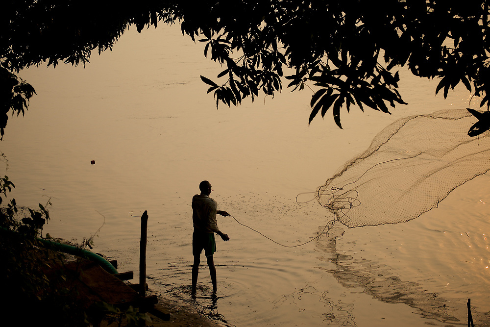 A local man casts the net during an early morning fishing session at the River Nile in Juba, South Sudan.