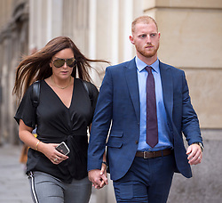© Licensed to London News Pictures. 07/08/2018. Bristol, UK. England cricketer BEN STOKES and his wife CLARE RATCLIFFE at lunchtime outside Bristol Crown court today for the second day of his trial on charges of affray that relate to a fight outside a Bristol nightclub on September 25 2017. Stokes and two other men, Ryan Ali, 28, and Ryan Hale, 27, all deny the charge. Stokes, Ali and Hale are jointly charged with affray in the Clifton Triangle area of Bristol on September 25 last year, several hours after England had played a one-day international against the West Indies in the city. A 27-year-old man allegedly suffered a fractured eye socket in the incident. Photo credit: Simon Chapman/LNP