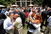 Nearly 50 couples kiss and embrace after being pronounced as married during the 101 Gay Weddings event put on by Chef Art Smith at the Intercontinental Hotel in Buckhead on Sunday, June 28. Two days prior, on Friday, June 26, 2015, the United State Supreme Court ruled that a state's ban on same-sex marriages is unconstitutional. (David Welker)