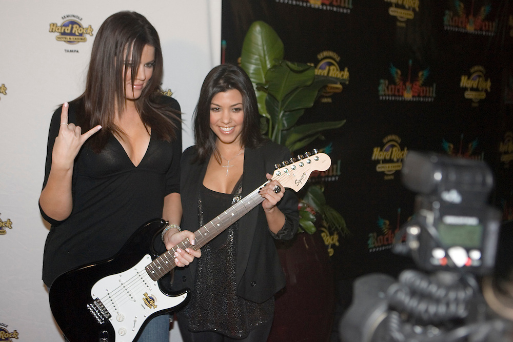 TP_301075_FREE_sb_hardrock..Caption:(Saturday, 01/31/2009 Tampa)Khloe and Kourtney Kardashian pose for photos on the red carpet during Rock & Soul Super Saturday Night at Seminole Hard Rock Hotel & Casino...Summary:Rock & Soul Super Saturday Night..Photo by James Branaman Kardashians.
