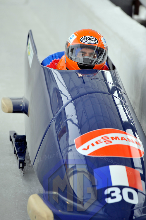 15 December 2007:  The  France 1 sled driven by Mickael Serise with Alexandre Jolivet on the brakes competes in the FIBT World Cup Men's 2-man bobsled competition on December 15, 2007 at the Olympic Sports Complex in Lake Placid, NY.   The race was won by the Canada 1 sled with a time of 1:50.64.