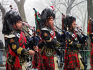 Cold pipers on a snowy St. Patrick's Day in New York City.