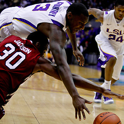 Jan 16, 2013; Baton Rouge, LA, USA; LSU Tigers forward Jalen Courtney (3) and South Carolina Gamecocks forward Lakeem Jackson (30) scramble for a loose ball during the first half of a game at the Pete Maravich Assembly Center. Mandatory Credit: Derick E. Hingle-USA TODAY Sports