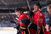 PENTICTON, CANADA - SEPTEMBER 8: Rasmus Andersson #54 and Cliff Watson #73 of the Calgary Flames stand on the bench against the Edmonton Oilers on September 8, 2017 at the South Okanagan Event Centre in Penticton, British Columbia, Canada.  (Photo by Marissa Baecker/Shoot the Breeze)  *** Local Caption ***