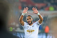Swansea Captain Ashley Williams waves to fans at full time.<br /> Barclays Premier league match, Swansea city v Crystal Palace at the Liberty stadium in Swansea, South Wales on Saturday 29th November 2014<br /> pic by Phil Rees, Andrew Orchard sports photography.