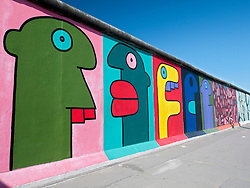 Paintings on original Berlin Wall at East Side Gallery in Berlin Germany