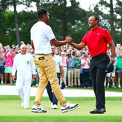 Apr 14, 2019; Augusta, GA, USA; Tiger Woods (right) greets Tony Finau after putting on the 18th green during the final round of The Masters golf tournament at Augusta National Golf Club. Photo : Rob Schumacher / SUSA / Icon Sport