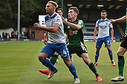 Bury Forward, Hallam Hope (24) and Scunthorpe United Defender, Harry Toffolo (15) during the EFL Sky Bet League 1 match between Bury and Scunthorpe United at the JD Stadium, Bury, England on 1 October 2016. Photo by Mark Pollitt.