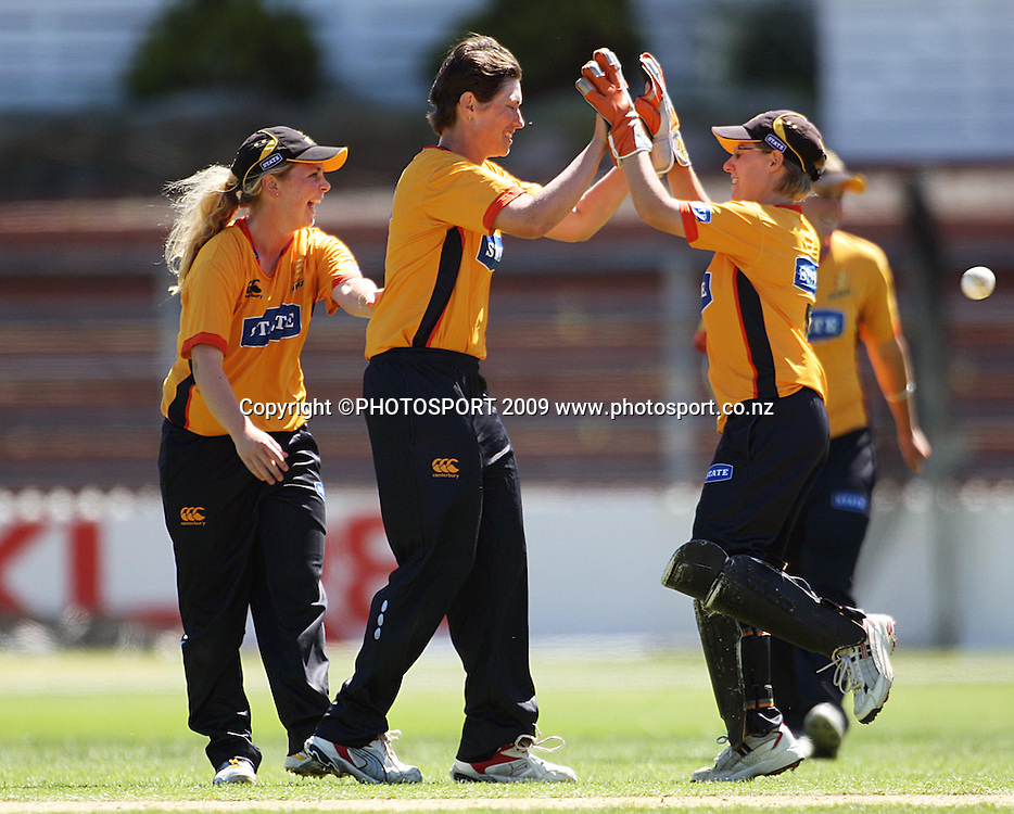 Wellington captain and bowler Anna Dodd congratulates keeper Andrea Stockwell for stumping Frances McKay alongside Lucy Doolan (left).<br /> State League final. Wellington Blaze v Canterbury Magicians at Allied Prime Basin Reserve, Wellington. Saturday, 24 January 2009. Photo: Dave Lintott/PHOTOSPORT