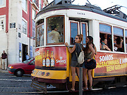 Young women take a trolley on Lisbon.PHOTO PAULO CUNHA/4SEE