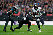 Jacksonville Jaguars Linebacker Myles Jack (44) tackles Houston Texans Tight End Jordan Akins (88) during the International Series match between Jacksonville Jaguars and Houston Texans at Wembley Stadium, London, England on 3 November 2019.