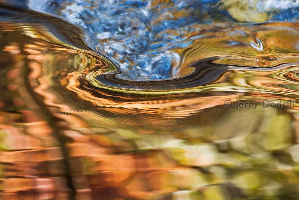 Abstract autumn reflection in Merced River Canyon, Yosemite National Park, California