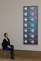 "Bonhams, Mayfair, London. A woman admires Andy Warhol's ""Fourteen Small Electric Chairs"", estimated to fetch between £4-6 million, to be auctioned at Bonhams post-war and Contemporary art sale. .///FOR LICENCING CONTACT: paul@pauldaveycreative.co.uk TEL:+44 (0) 7966 016 296 or +44 (0) 20 8969 6875. ©2015 Paul R Davey. All rights reserved."