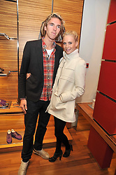 JAMES COOK and POPPY DELEVIGNE at a party in aid of the charity Best Buddies held at the Hogan store, 10 Sloane Street, London SW10 on 13th May 2009.