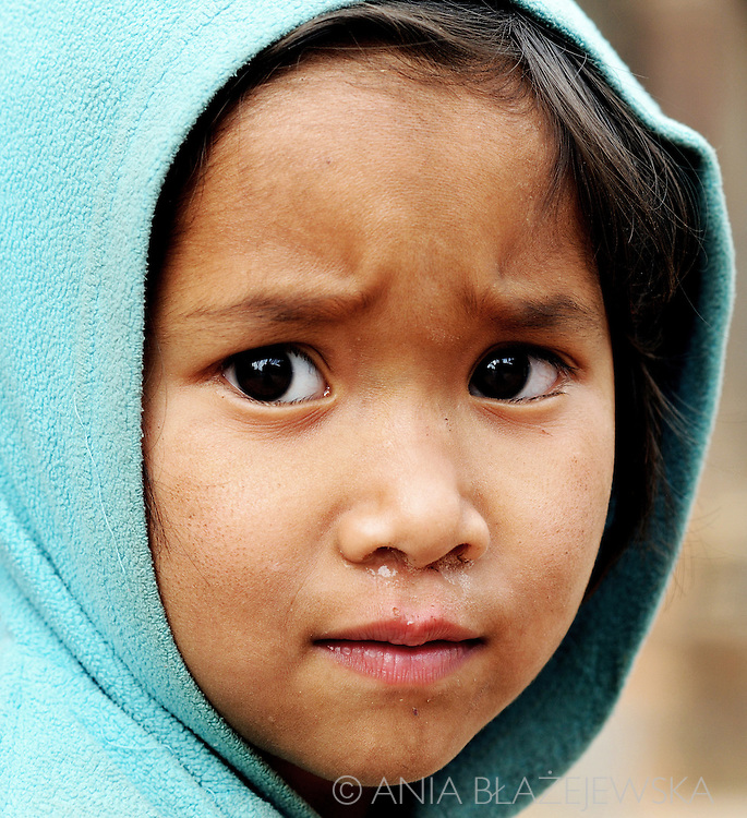 Nepal, Patan. Sad girl from Durbar square in Patan.