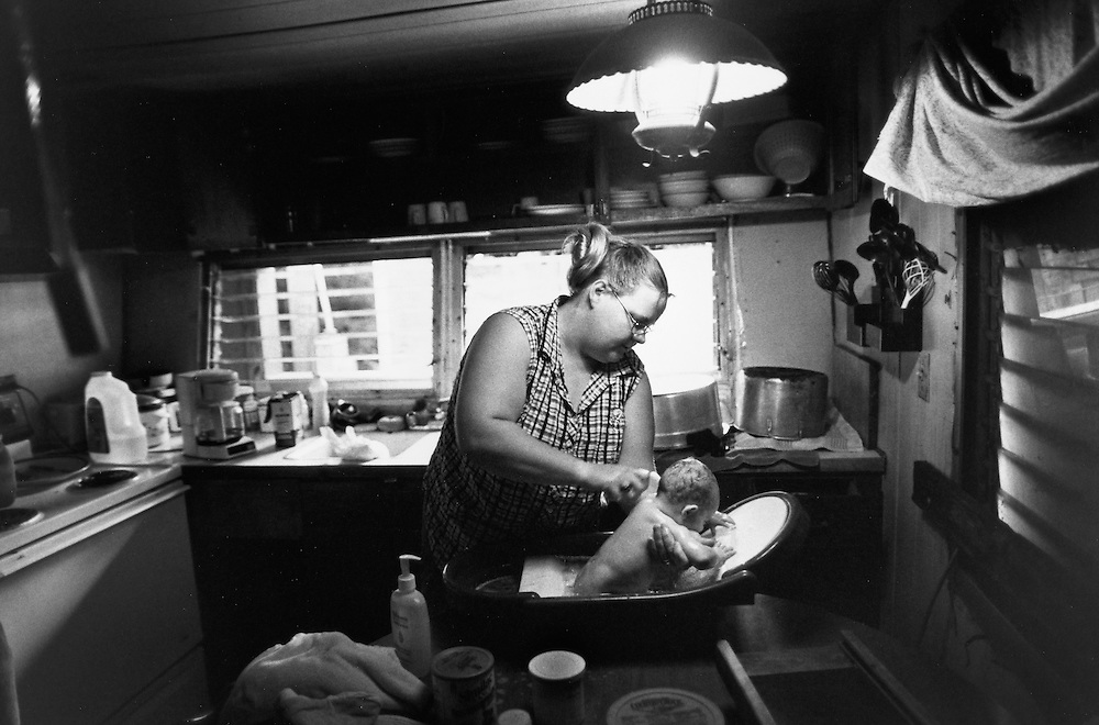 Robin King gives her baby a bath in the kitchen of her home in Shock, WV.