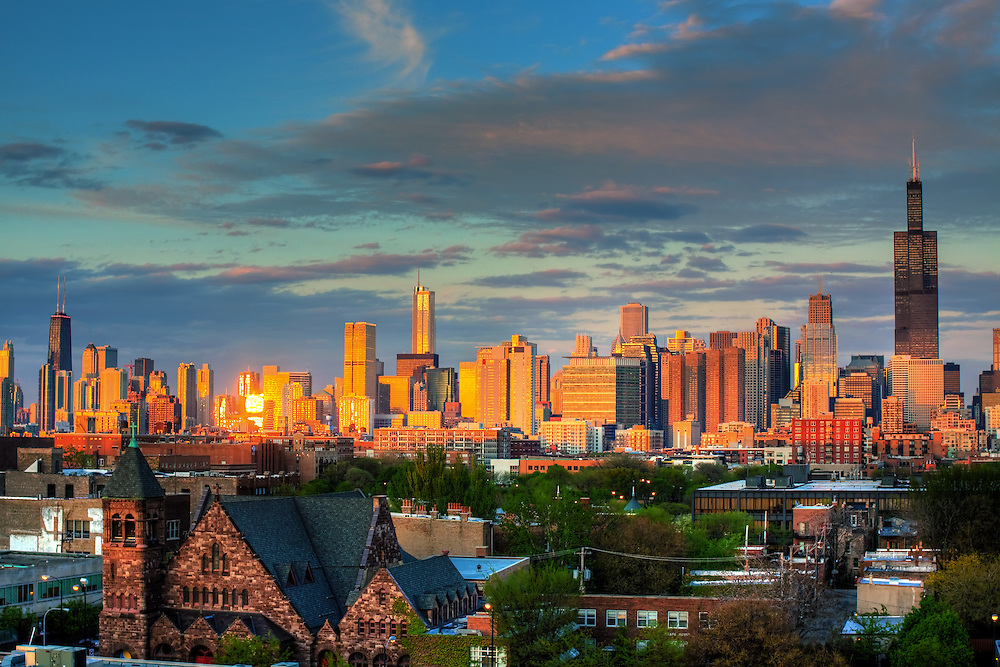 Viewed from the west side of the city, the famous Chicago skyline reflects the late evening sun.