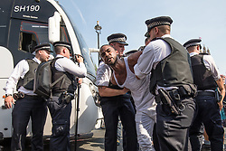 © Licensed to London News Pictures. 21/06/2017. London, UK. Police arrest a man at the 'Day of Rage' protest in Parliament Square. The demonstration is calling for justice for the victims of the Grenfell Tower fire. Photo credit: Rob Pinney/LNP