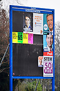 Nederland, Millingen, 16-2-2017Verkiezingsbord met affiches voor de komende verkiezingen voor de tweede kamer.Het bord is niet vol, veel partijen hebben hier nog geen posters geplakt. verkiezingsposters.Netherlands, election board with posters for the forthcoming national elections.Foto: Flip Franssen