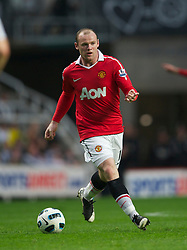 NEWCASTLE, ENGLAND - Tuesday, April 19, 2011: Manchester United's Wayne Rooney in action against Newcastle United during the Premiership match at St James' Park. (Photo by David Rawcliffe/Propaganda)