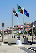 The flags of Portugal, the European Union and the Municipal Flag of Lison fly high above a plaza in Liabon, Portugal.