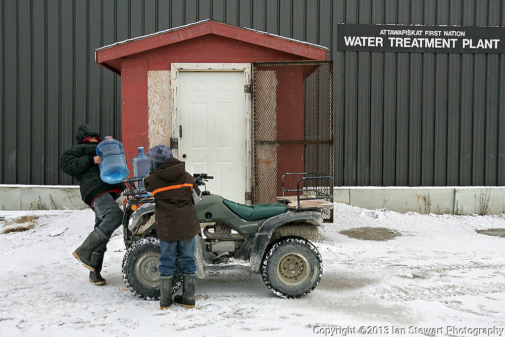Bottled drinking water is collected at the water treatment plant. Attawapiskat's tap water has not been safe to drink since the early 1990's.<br /> <br /> (Ian Stewart photo)
