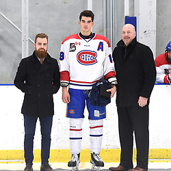 TORONTO, ON  - FEB 18,  2018: Ontario Junior Hockey League game between the Toronto Jr. Canadiens and the St. Micheal's Buzzers, Jack McBain #19 of the Toronto Jr. Canadiens receives the Kewl Sports OJHL Player of the month award from Toronto Jr. Canadiens GM Blake Ricci and OJHL Director of Hockey Operations Chris Vanstone during a special pregame ceremony.<br /> (Photo by Andy Corneau / OJHL Images)