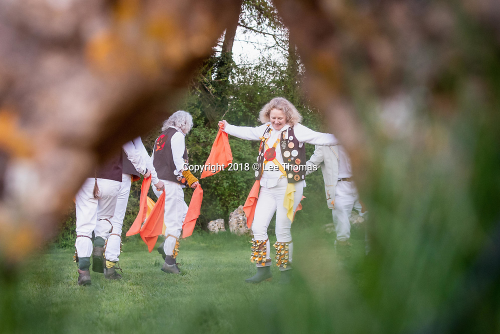 Rollright Stones, Nr Long Compton, Oxfordshire / Warwickshire, UK. 1st May 2018.  Members of the Owlswick Morris side entertain spectators at sunrise with traditional dancing at the historic Rollright Stones to celebrate the 1st May.  The Rollright Stones is a complex comprising of three Neolithic and Bronze Age megalithic monuments near the village of Long Compton, on the borders of Oxfordshire and Warwickshire. Made from local oolitic limestone, the three monuments now known as the King's Men and the Whispering Knights in Oxfordshire and the King Stone in Warwickshire, were built at separate periods in late prehistory.  // Lee Thomas, Tel. 07784142973. Email: leepthomas@gmail.com  www.leept.co.uk (0000635435)