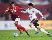 GUANGZHOU, CHINA - MARCH 16:  Muto Yuki of Urawa Red Diamonds (R) being followed by Bezerra Maciel Junior (Paulinho) of Guangzhou Evergrande (L) during the AFC CHampions League match between Guangzhou Evergrande and Urawa Red Diamonds on March 16, 2016 in Guangzhou, China.  (Photo by Aitor Alcalde Colomer/Getty Images)