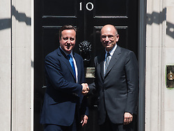 Prime Minister David Cameron (L) meets with Italian Prime Minster Enrico Letta at 10 Downing Street. <br /> Mr Letta is in the UK on a two day visit.<br /> 10 Downing Street, London, United Kingdom<br /> Wednesday, 17th July 2013<br /> Picture by Piero Cruciatti / i-Images