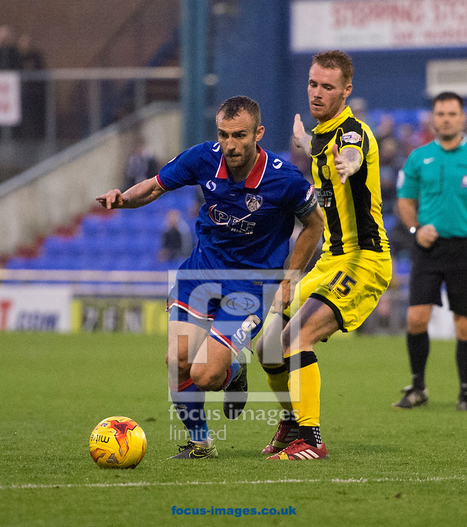 Liam Kelly of Oldham Athletic (left) gets past Tom Naylor of Burton Albion during the Sky Bet League 1 match at Boundary Park, Oldham<br /> Picture by Russell Hart/Focus Images Ltd 07791 688 420<br /> 31/10/2015