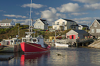 Red fishing boat and fisherman's shacks at Peggy's Cove Nova Scotia