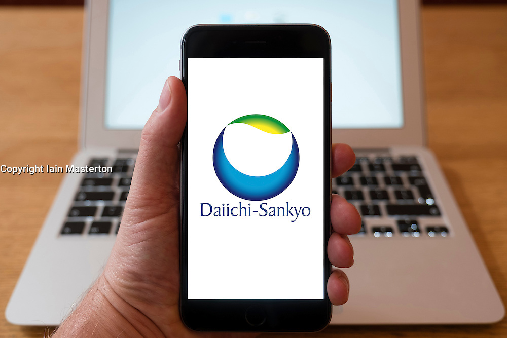 Using iPhone smartphone to display logo of Daiichi-Sankyo; a global pharmaceutical company