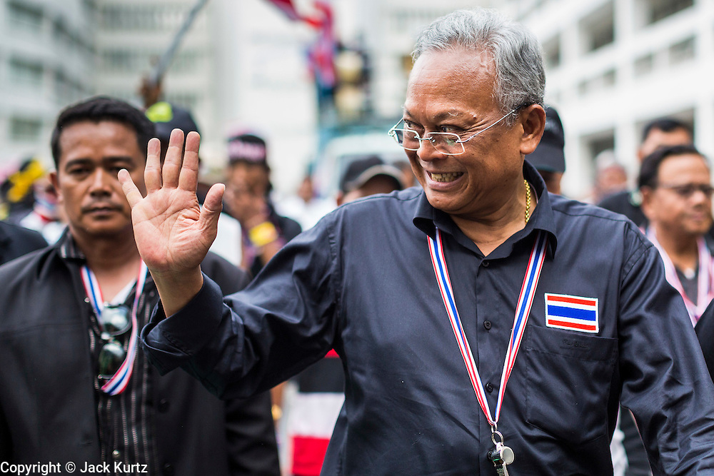 SUTHEP THAUGSUBAN, leader of the anti-government protests rocking Bangkok, walks through the Ministry of Finance complex. The Thai government issued as warrant for Suthep as the protests spread but he has not been arrested. Protestors opposed to the government of Thai Prime Minister Yingluck Shinawatra spread out through Bangkok this week. Protestors have taken over the Ministry of Finance, Ministry of Sports and Tourism, Ministry of the Interior and other smaller ministries. The protestors are demanding the Prime Minister resign, the Prime Minister said she will not step down. This is the worst political turmoil in Thailand since 2010 when 90 civilians were killed in an army crackdown against Red Shirt protestors. The Pheu Thai party, supported by the Red Shirts, won the 2011 election and now govern. The protestors demanding the Prime Minister step down are related to the Yellow Shirt protestors that closed airports in Thailand in 2008.
