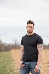 sad muscular man outdoors