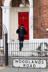 © Licensed to London News Pictures . 09/10/2012 . Altrincham , UK . Police entering a property on Woodlands Road, Altrincham , Cheshire on October 9,2012 where a search continues following the arrest of Jimmy Savile's former chauffeur , Ray Teret , and housemate Alan Ledger , yesterday (8th November) over historic child rape allegations . Photo credit : Joel Goodman/LNP