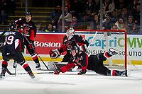 KELOWNA, CANADA - JANUARY 4: Josh Maser #11 tries to block a shot on Taylor Gauthier #35 of the Prince George Cougars during second period against the Kelowna Rockets on January 4, 2019 at Prospera Place in Kelowna, British Columbia, Canada.  (Photo by Marissa Baecker/Shoot the Breeze)