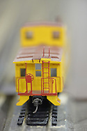 Hicksville, New York, USA. February 22, 2015. A Union Pacific yellow caboose model train car travels on the track at the Model Train Exhibit ihsted by Trainville Hobby Depot at the Broadway Mall. Donations were accepted at exhibit to support the Nassau County Empire State Games for the Physically Challenged.