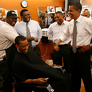 Senator Barack Obama jokes around with barber Kirby Talley, 41 at the Neighborhood Unisex Salon in Fort Lauderdale.
