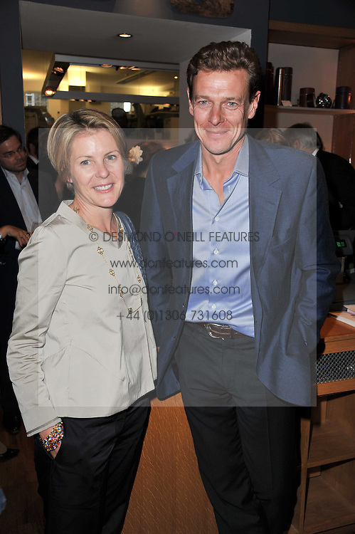 Left to right, VISCOUNTESS LINLEY and JAMES OGILVY at a party to celebrate the publication of 'Garden' by Randle Siddeley held at Linley, 60 Pimlico Road, London on 24th May 2011.