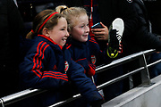 Young Arsenal fans smiling after the FA Women's Super League match between Tottenham Hotspur Women and Arsenal Women FC at Tottenham Hotspur Stadium, London, United Kingdom on 17 November 2019.
