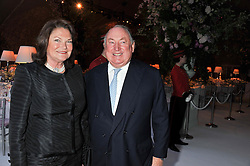 ANTHONY & ANTOINETTE OPPENHEIMER at a dinner hosted by Cartier following the following the opening of the Chelsea Flower Show 2012 held at Battersea Power Station, London on 21st May 2012.