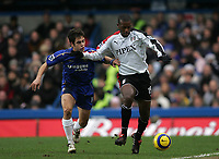 Photo: Lee Earle.<br /> Chelsea v Fulham. The Barclays Premiership. 26/12/2005. Chelsea's Joe Cole (L) chases Phillippe Christanval for the ball.