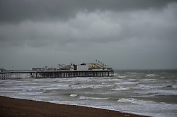 © Licensed to London News Pictures. 15/09/2015. Brighton, UK. Brighton Pier surrounded by grey skies and rough seas as high winds and heavy rain batter Brighton seafront on  the south coast of England.  Photo credit: Ben Cawthra/LNP