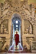 Buddhist monks lighting candles, Mrauk U, Myanmar