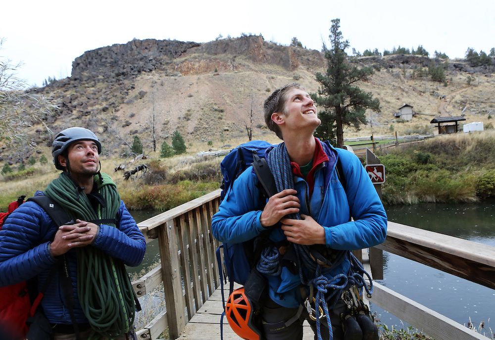 "The film adaptation of Cheryl Strayed's memoir, ""Wild,"" stars Reese Witherspoon as a troubled woman who challenges herself by hiking the Pacific Crest Trail in Oregon. Mountain guides Billy Haas, left, and Caleb Ladue cross the Crooked River after hiking and climbing on Smith Rock in Terrebonne, Ore. Here they look up at the Monkey Face and the Picnic Lunch Wall they just climbed."