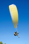 paragliding on blue sky background