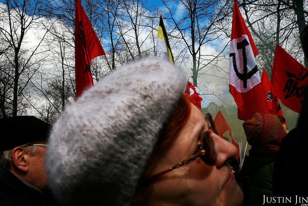 Supporters of Russia's opposition gather in central Moscow to protest President Vladimir Putin's government. They are surrounded by Communist flags. .Police detained Garry Kasparov, the former world chess champion who now leads one of Russia's strongest opposition movements, and 170 other activists as they gathered for the forbidden anti-Kremlin demonstration..The demonstration, one in a series of so-called Dissenters' Marches, increased tension between opposition supporters who complain the Kremlin is cracking down on political dissent and authorities who vow to block any unauthorized demonstrations.